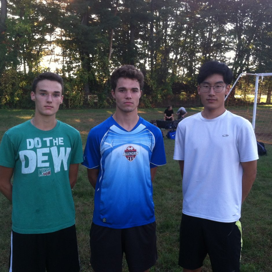 Wil Larson, center, is flanked by Connor Barber and James Kim, the other tri-captains at ND-BG.