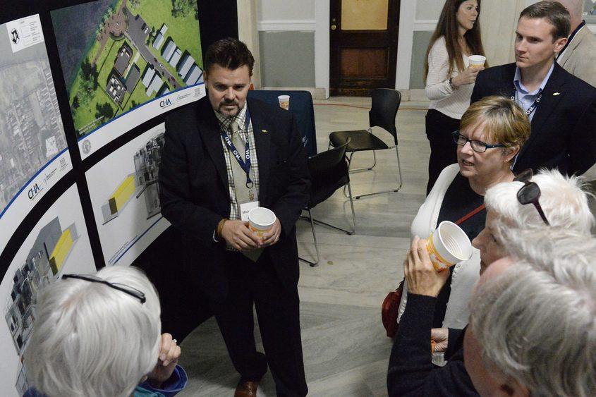 Stockade residents listen to Michael Miller of CHA on Thursday.