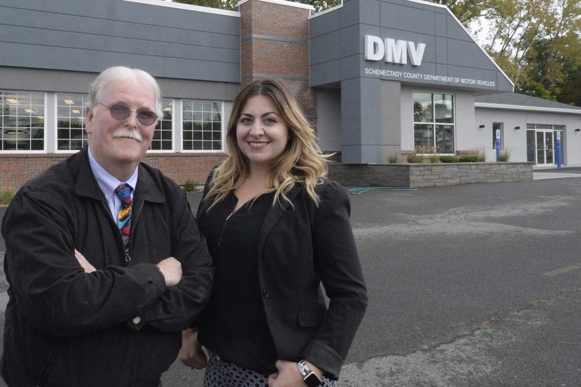 Schenectady County Clerk John Woodward and Deputy County Clerk Cara Jasenski stand in front of the new DMV.