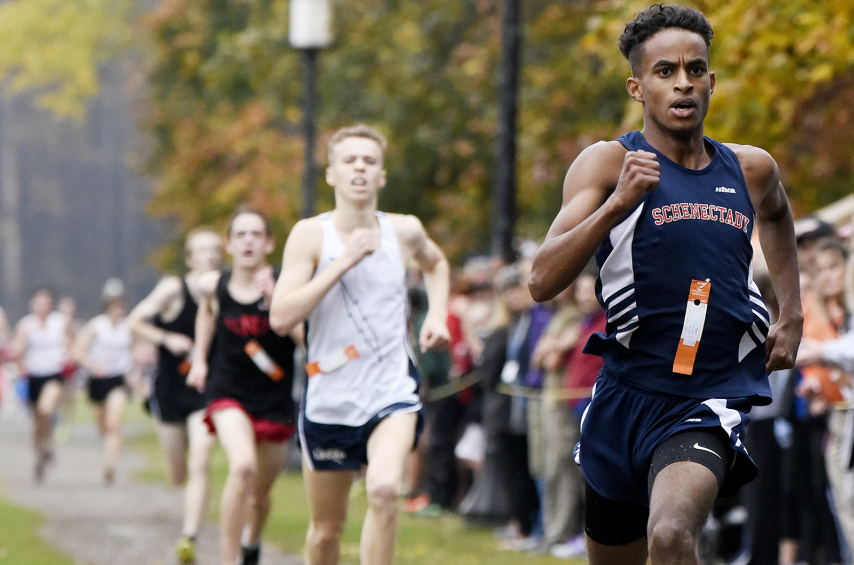 Schenectady's Maazin Ahmed takes first in the Section II Class A boys' cross country championship Friday.