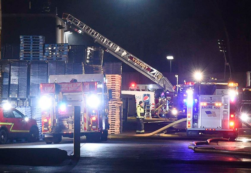 Fire crews on the scene of a fire at the Pepsi bottling plant in Latham on Nov. 15, 2017.