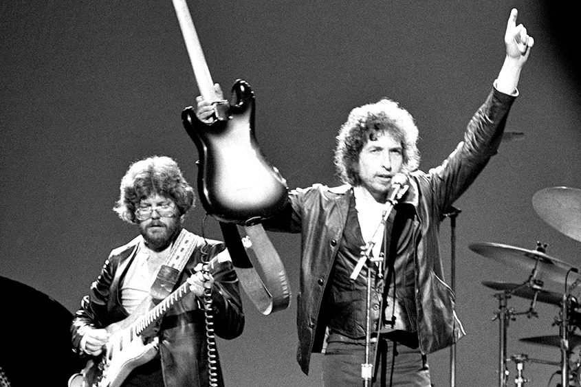 Bob Dylan points to heaven during a show at the Palace in April 1980.