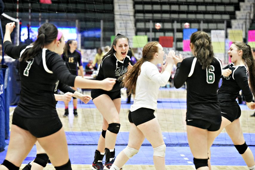 Shenendehowa celebrates a point during Saturday's state volleyball tournament.