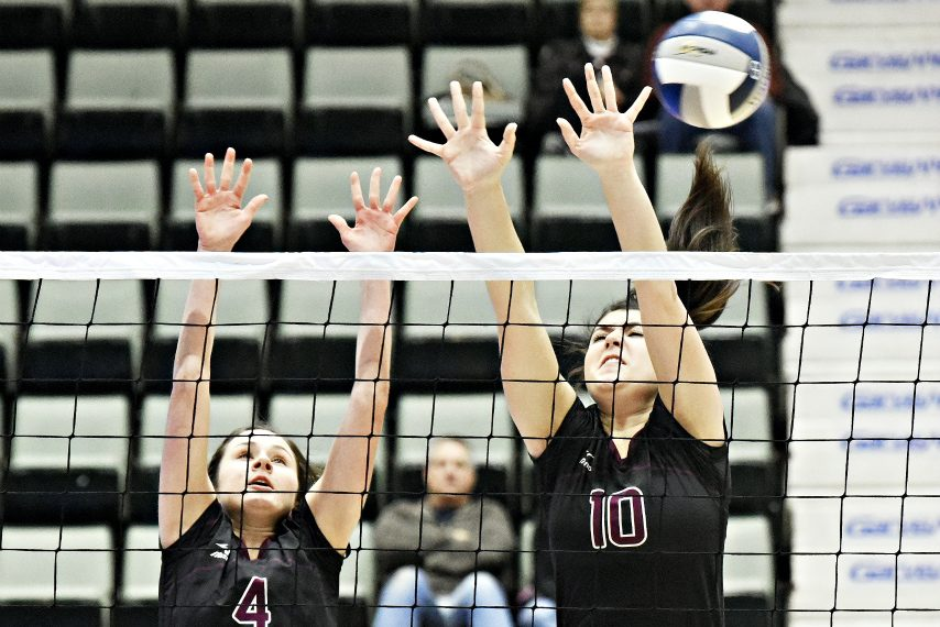 Burnt Hills' Jess Langan and Myla Dobson leap at the net during Saturday's semifinals.