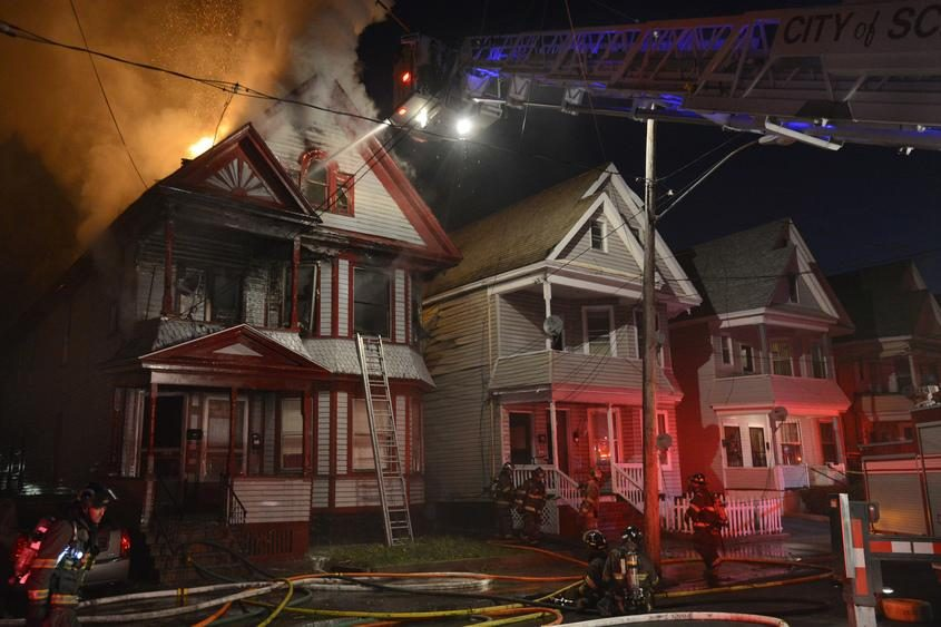 Schenectady firefighters battle a blaze at 428 Hulett St. on May 2, 2013, in Schenectady.