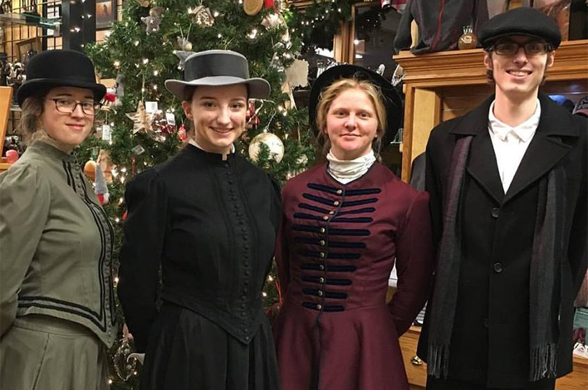 Victorian fashions are modeled by Jamie Onderdonk, Alexa Benware, Maddy Zanetti and Austin Peterson at Impressions of Saratoga.