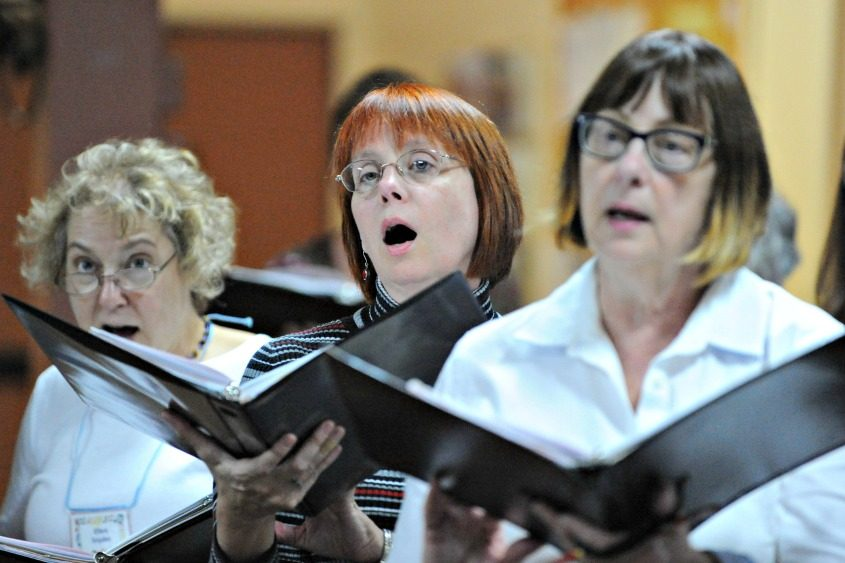 The Mohawk Valley Chorus rehearses for its holiday concert.