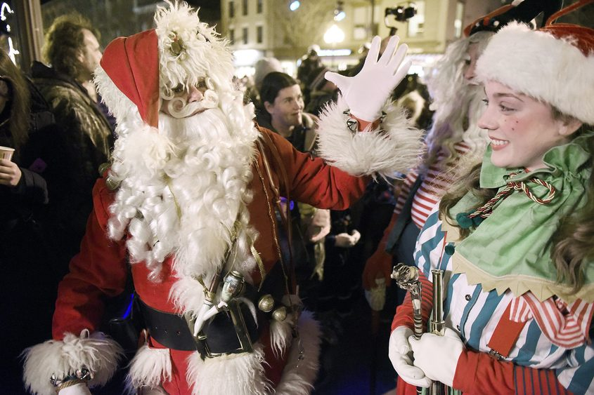 Santa Claus arrives to his post during the 31st annual Victorian Streetwalk on Thursday.
