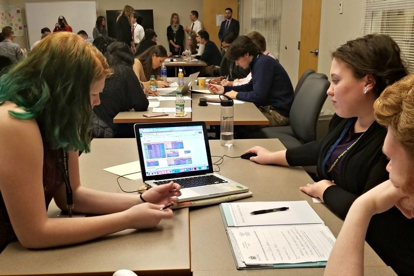 Students from Schenectady, Fort Plain and Mohonasen schools work on an imaginary school budget Tuesday.