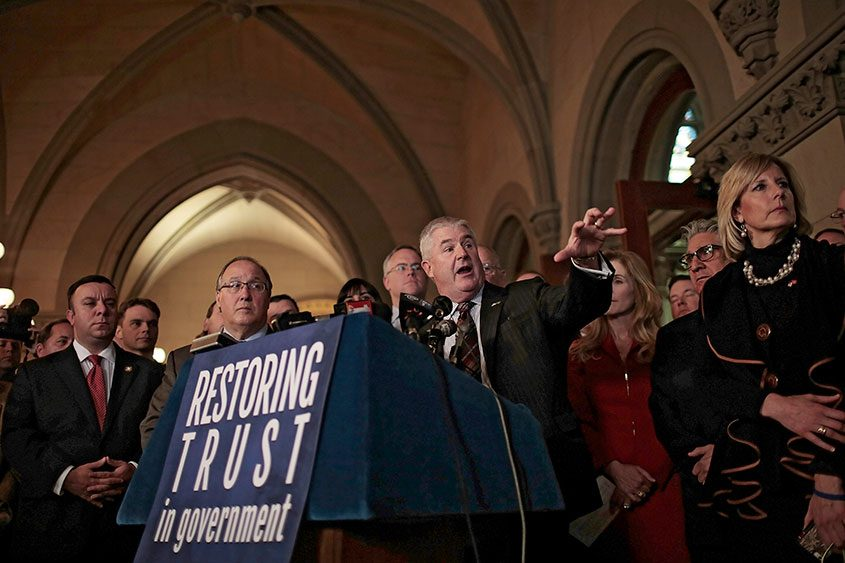 New York Assembly Minority Leader Brian Kolb (center) speaks during a 2016 news conference about ethics reform in Albany.