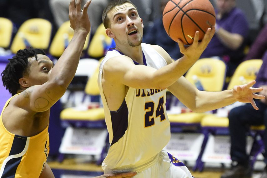 UAlbany's Joe Cremo goes for a layup against Canisius.
