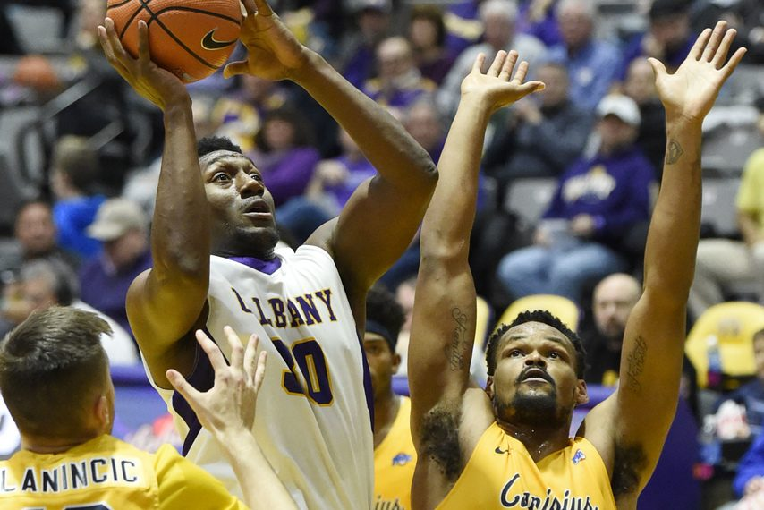 UAlbany's Travis Charles goes for a shot during Saturday's game at SEFCU Arena.