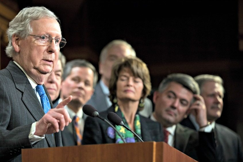 Senate Majority Leader Mitch McConnell is joined by other Senate Republicans at a Capitol Hill news conference early Wednesday.