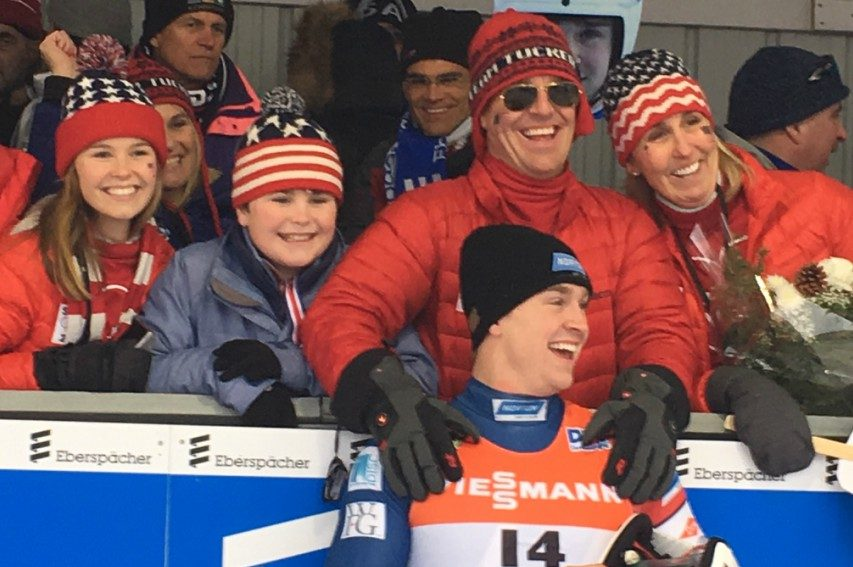 Tucker West with parents Brett and Pam (right) after West won bronze in the men's singles Luge World Cup race last weekend.