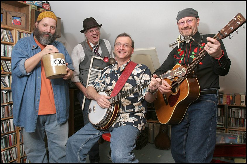Paul Jossman, also known as Bowtie, is surrounded by fellow Ramblin' Jug Stompers Michael Eck, Greg Haymes and Clyde Stewart.