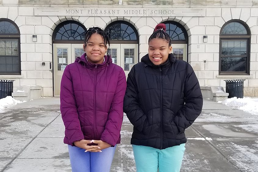 Sisters Kamiah (left) and Kiani Beatty-Baker are seen outside Mont Pleasant Middle School in Schenectady.