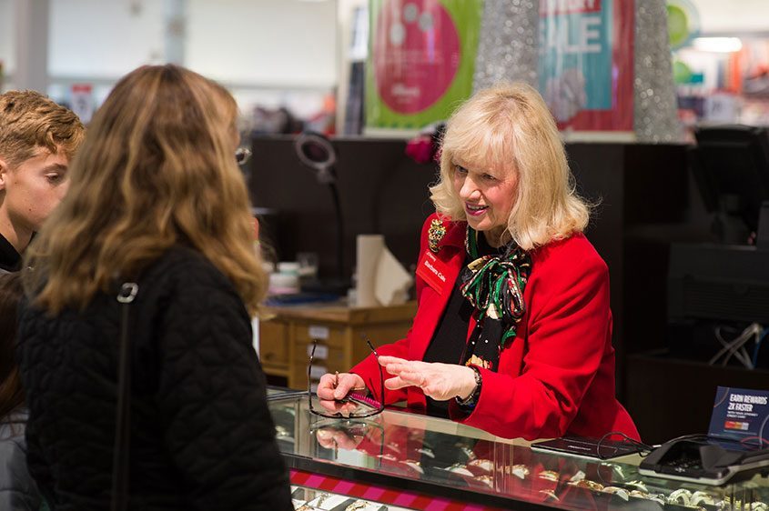 Barbara Cake shows watches to customers at the J.C. Penney jewelry counter in Hermitage, Pennsylvania, on Dec. 23, 2017.