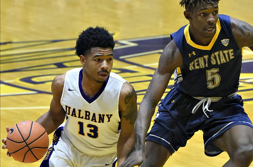 UAlbany's David Nichols (left) drives to the basket against Kent State.
