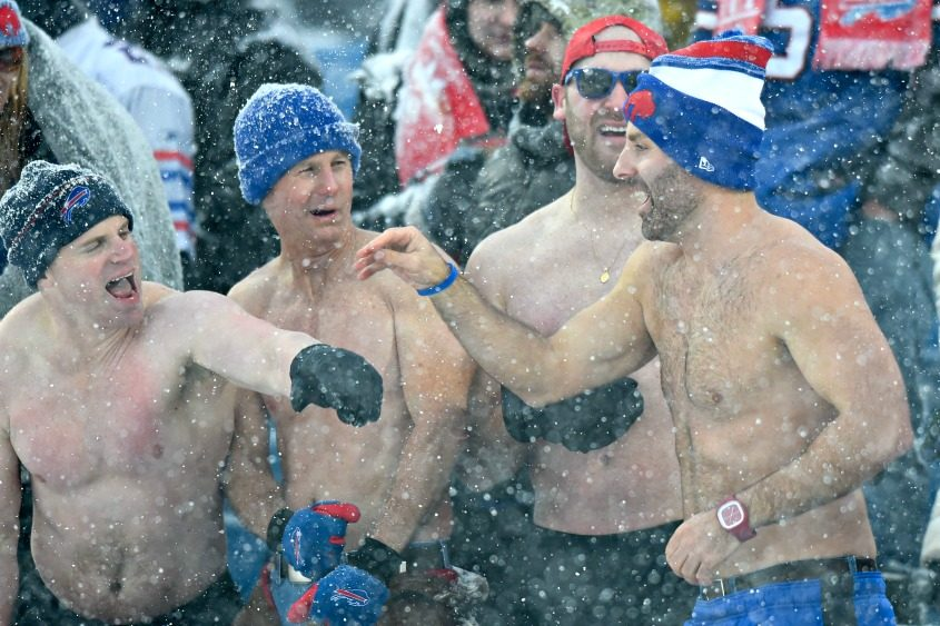 Buffalo Bills fans celebrate during a snowstorm and a 13-7 Bills win at New Era Field on Dec. 10.