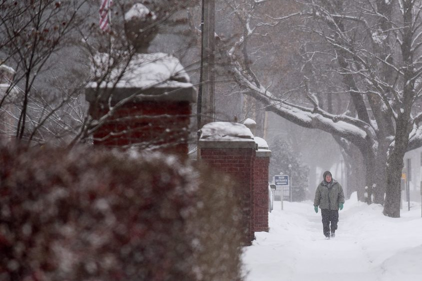 A man walks down Lake Avenue in Saratoga Springs on Thursday.