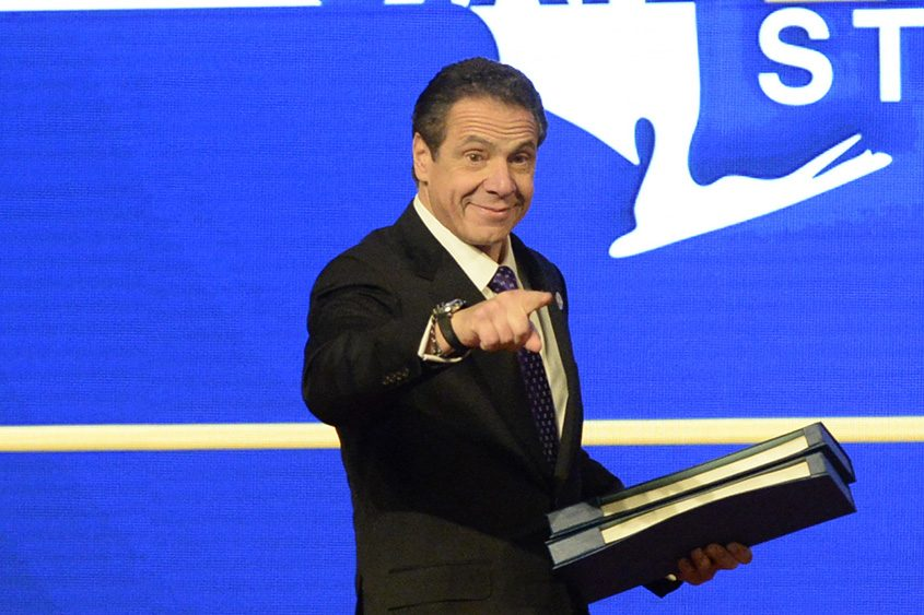 Gov. Andrew Cuomo points to a colleague before delivering his State of the State address Wednesday.