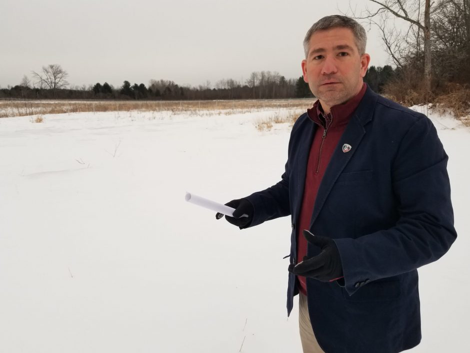 Broadalbin-Perth Superintendent Steve Tomlinson stands in front of the field that will house a 10-acre solar array.