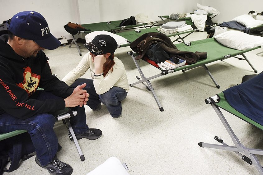 Residents relax on the second night of Code Blue Saratoga at Soul Saving Station Church in Saratoga Springs on Nov. 8.