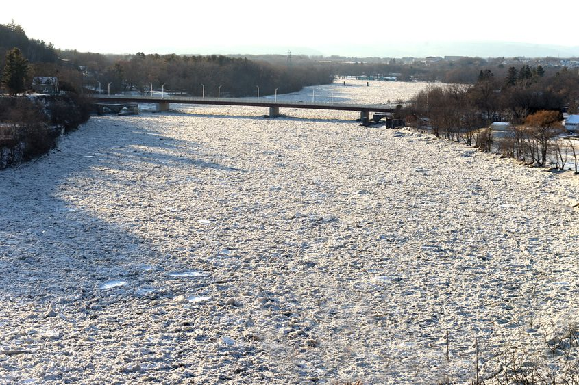 Ice builds up Monday on the Mohawk River along Riverview Road in Rexford.