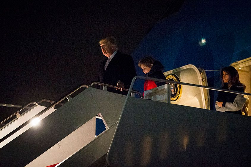 The Trumps disembark Air Force One as they head to Washington after a weekend in Florida on Jan. 15, 2018.