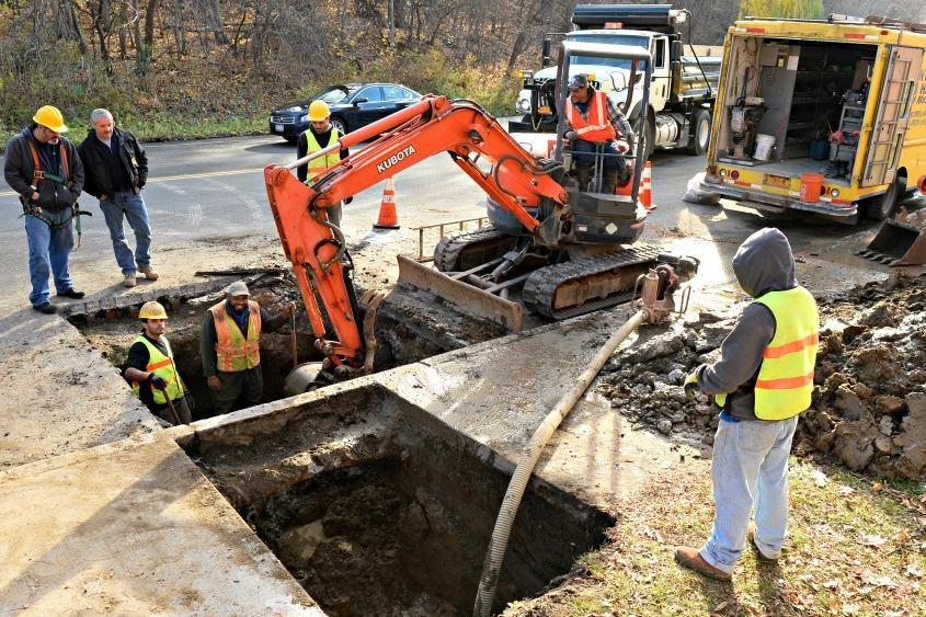 Schenectady Water Department workers repair a water main break on Millard Street in November 2016.
