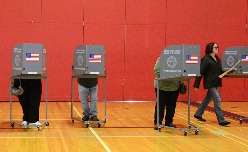 City residents vote at the Schenectady High School gymnasium in 2013.