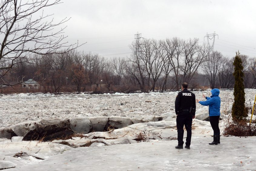Schenectady police keep a close eye on the Mohawk River on Tuesday.