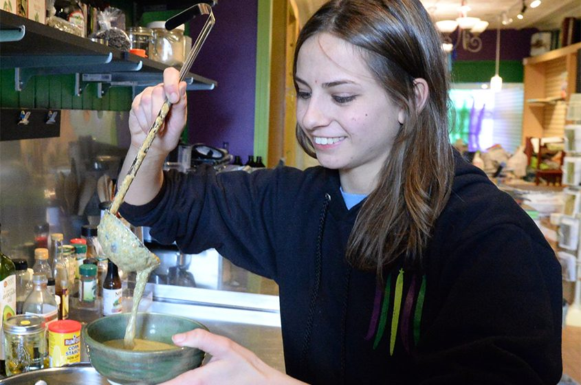 Abby Rockmacher ladles some cream of vegetable soup at The DillyBean on Jay Street.