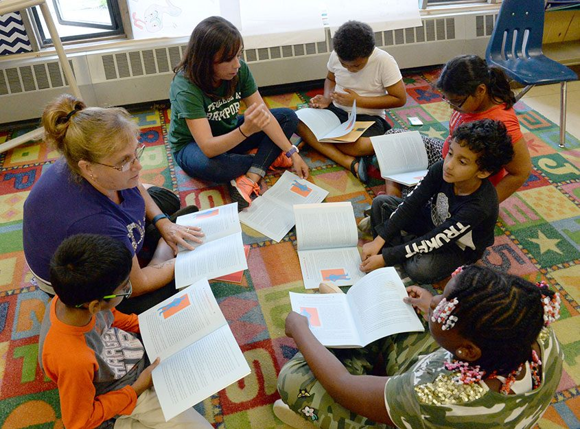 Students read together at Martin Luther King Jr. Elementary School's summer program, which serves more than 600 students.