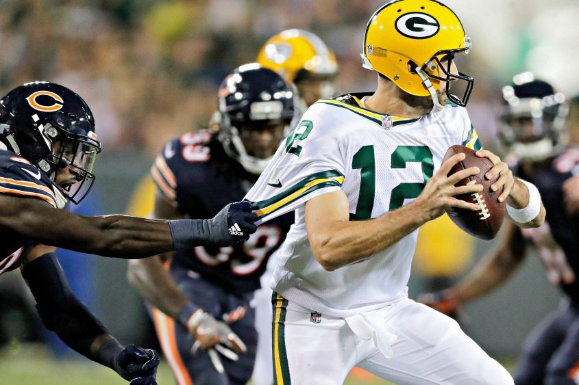 Green Bay Packers quarterback Aaron Rodgers runs away from Chicago Bears pressure during a Thursday night game in September.