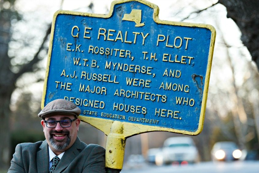 Chris Leonard stands next to the city's GE Realty Plot historical marker.