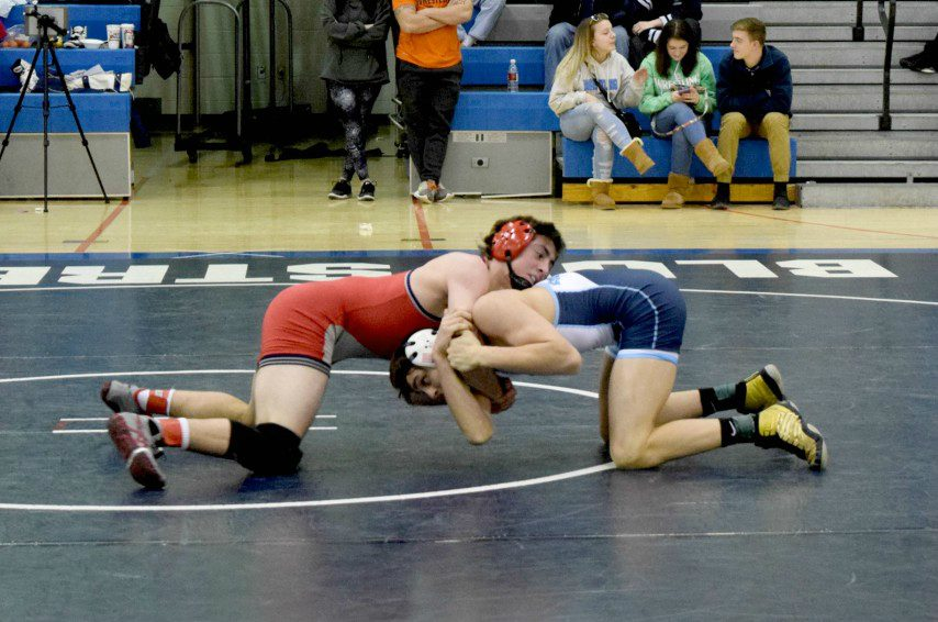 Eoghan Sweeney of Niskayuna (red) on his way to pinning Sam Bergin of Columbia on Saturday in the 160-pound Class A final.