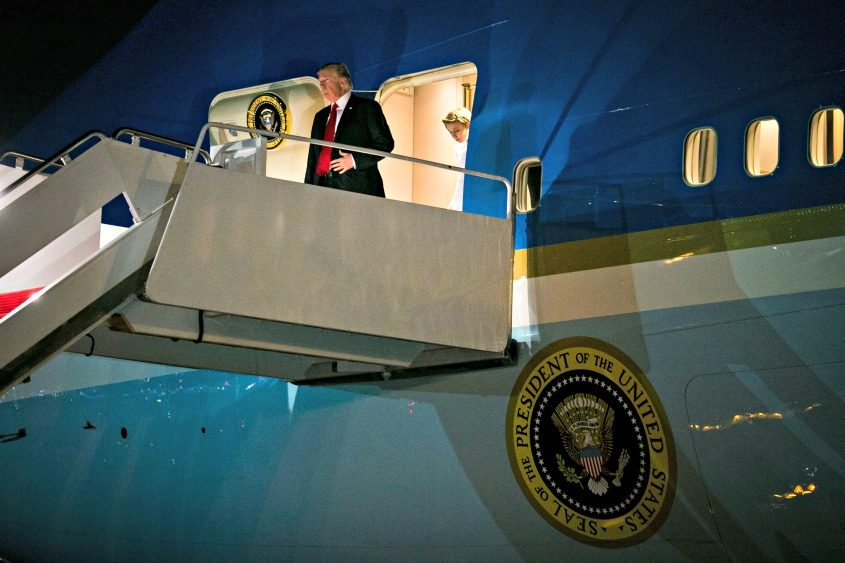 President Donald Trump arrives aboard Air Force One at Palm Beach International Airport in West Palm Beach, Fla., on Friday.