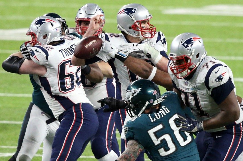 A hit by Philadelphia Eagles defensive end Brandon Graham forces a fumble by New England Patriots quarterback Tom Brady.