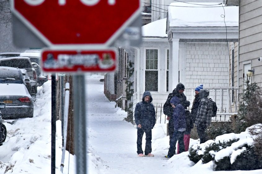 Residents stand outside of the Code Blue shelter in Saratoga Springs at 62 Henry St.