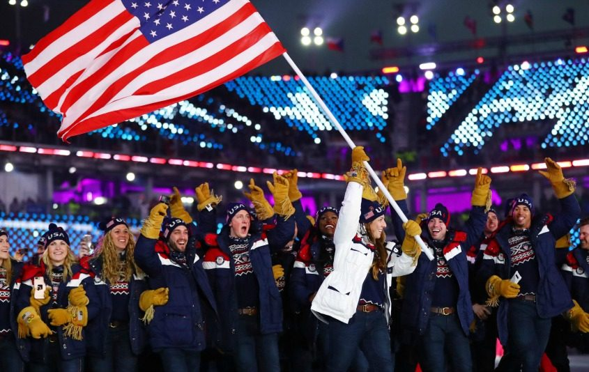 Team USA is seen during the Winter Olympics opening ceremonies wearing gloves that have their origins in Fulton County.