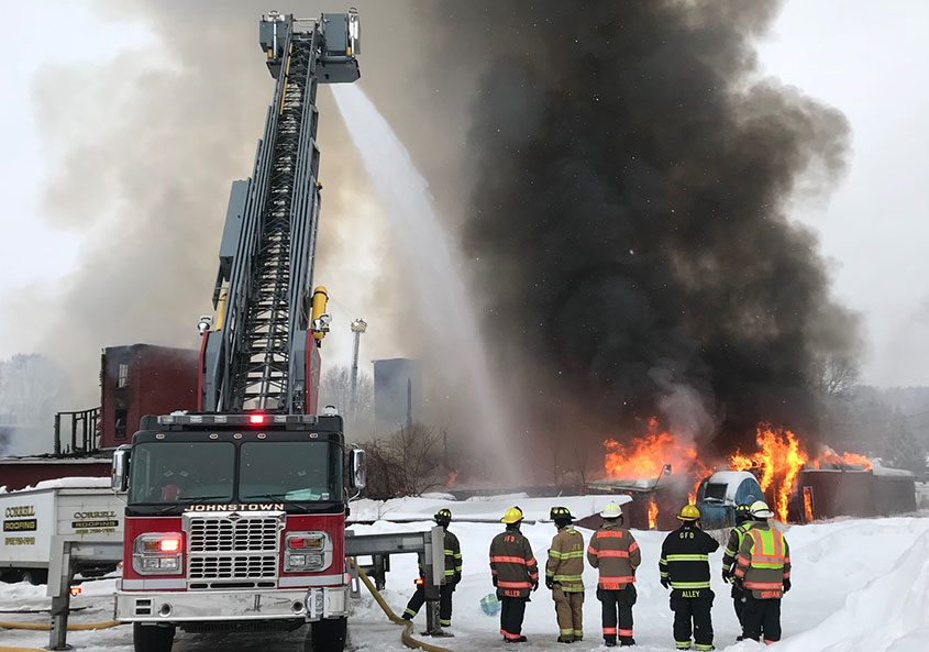Gloversville firefighters battle a three-alarm fire on 11th Avenue in a vacant tannery.