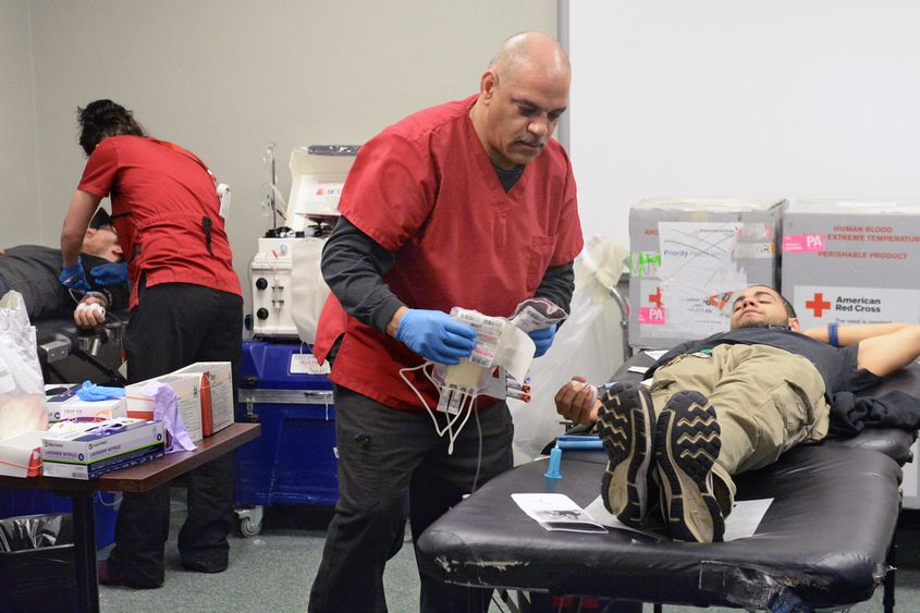 Jose Diaz (right) donates blood last week during a drive at Schenectady County Community College.