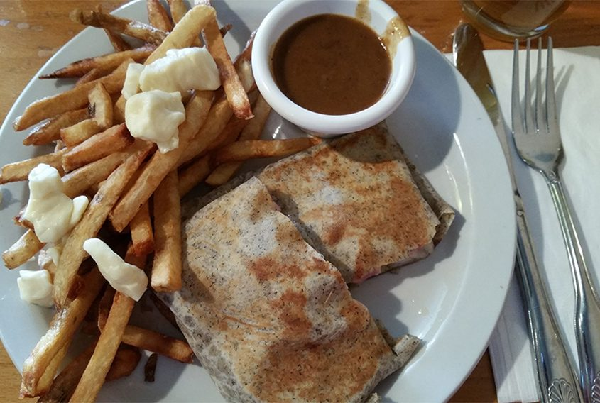 Green Mountain Savory Crepe and poutine with house gravy at Ravenous Creperie in Saratoga Springs.