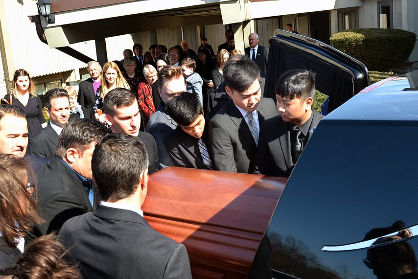 Joe Bena's casket is put into a hearse outside of Faith Baptist Church after his funeral service Monday morning.