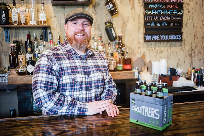 Chris Martell, a co-owner of Druthers Brewing Co., poses for a photo at the Saratoga Springs establishment.