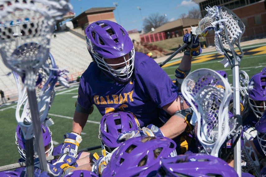 University at Albany players celebrate their 11-10 comeback win Saturday over Maryland at Maryland Stadium in College Park.