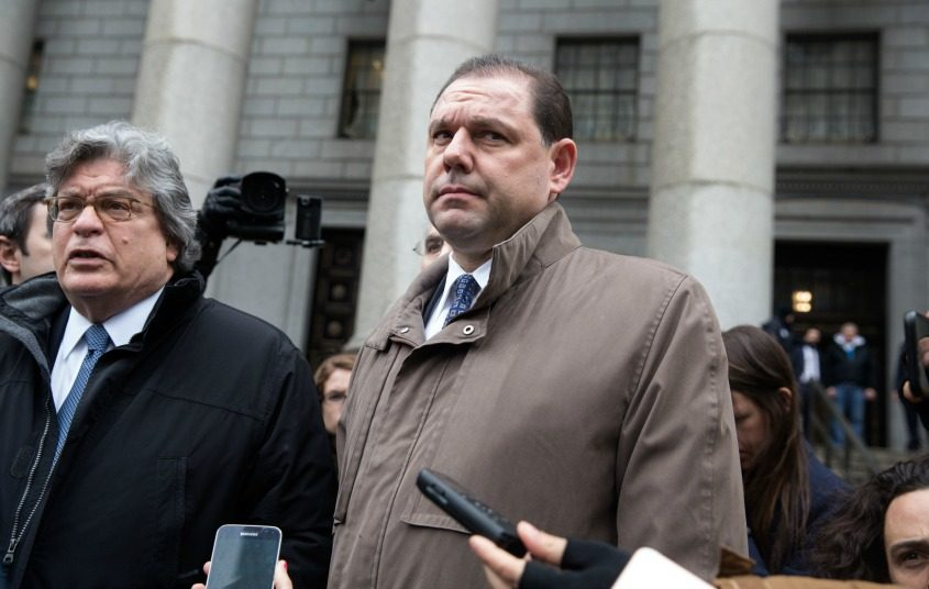 Joseph Percoco, center, a former top aide to Gov. Andrew Cuomo, is seen with his attorney on Tuesday.
