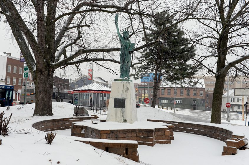 The Statue of Liberty is shown when it was located in Liberty Park.