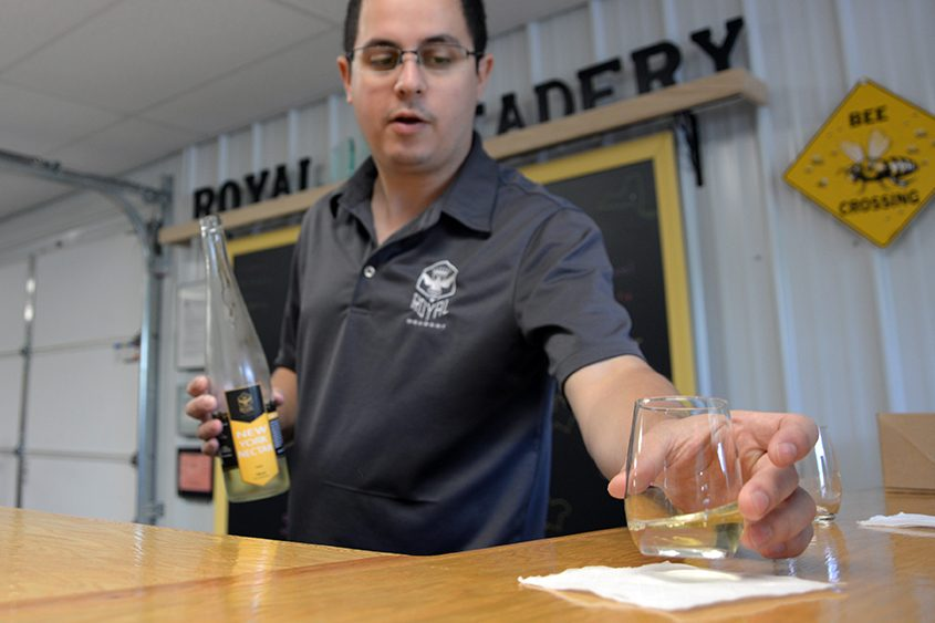 Royal Meadery owner Gregory Wilhelm pours a sample of mead during a stop on the Schoharie County Beverage Trail.